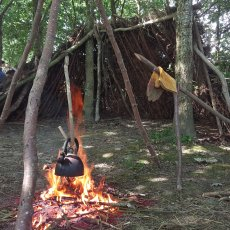 bushcraft, fire lighting, boiling kettle, shelter building